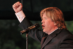 Peter Noone, fist in air, performing with Herman's Hermits at the Hamden Free Summer Concert Series. July 11, 2009 Town Center Park at Meadowbrook. Photo tweaked August 2011.