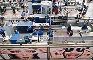 TSA Security personnel wait for passengers at Denver International Airport outside Denver, Colorado U.S. November 3, 2017.  REUTERS/Rick Wilking