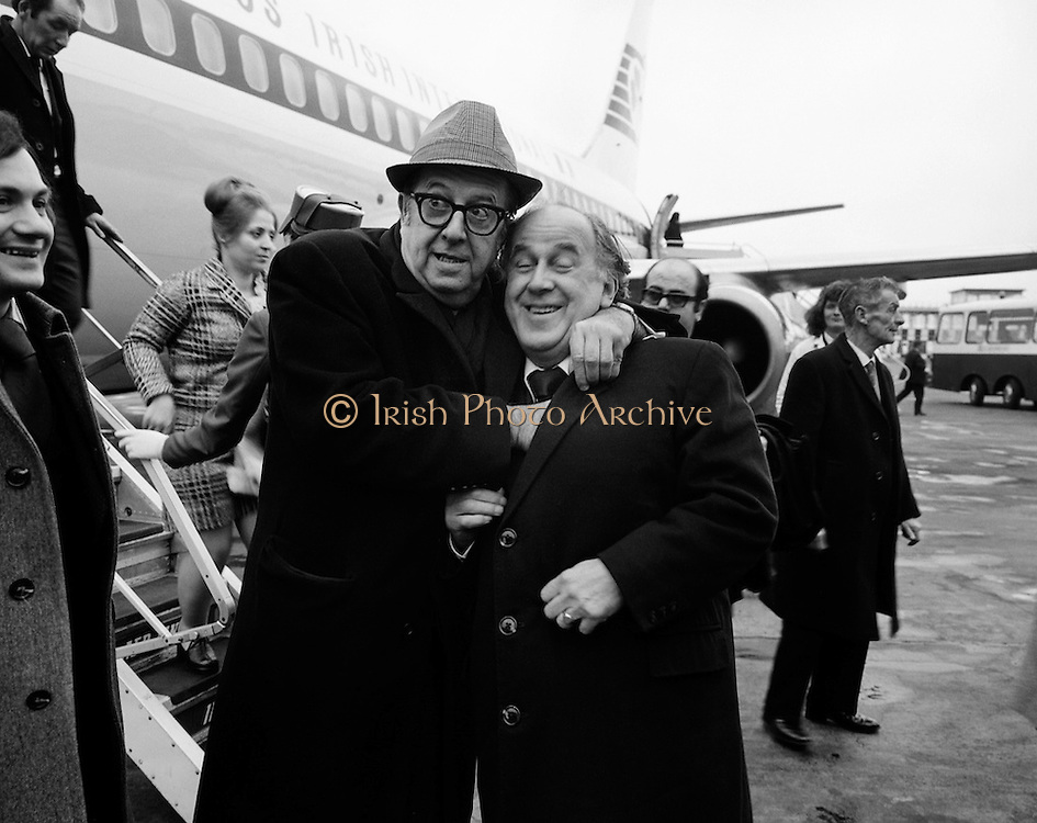 American comedian and actor Phil Silvers, most famous for his role as  'Sergeant Bilko' in the TV series, checks out the pockets of Joe Kearns, Manager of the Gaiety Theatre, on his arrival in Dublin to star in 'A Funny Thing Happened To Me on the Way to the Forum'.<br /> <br /> 09/03/1974