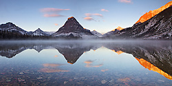 Mt. Sinopah reflects in the still waters of Two Medicine Lake at sunrise in Glacier National Park ~ can be printed 24x12 @ 300 dpi