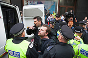 London, UK. Tuesday 11th June 2013. Protester is detained and taken awaaynin a police van during demonstration against the upcoming G8 summit in central London, UK.