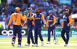India Mohammed Shami (centre) celebrates taking the wicket of England's Joe Root during the ICC Cricket World Cup group stage match at Edgbaston, Birmingham.
