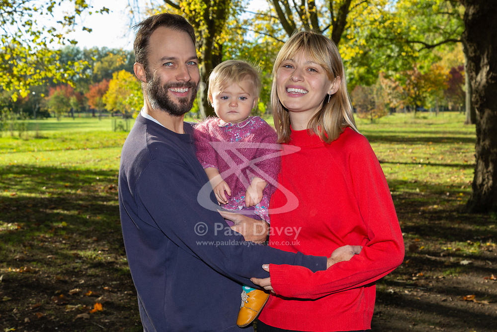 Mail Online: Couple Kim Marren, 31, a model and partner Maarten Ketels and actor together with their one-year-old daughter Willow who live on their barge Sunshine enjoy the dappled winter sunshine in the park adjacent to their mooring. North Hackney, London, November 02 2018.