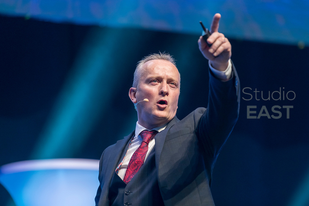 """Presentation """"How to make money with the Futuro Business"""" by Hugh-Paul Ward during the Presentation """"Future is now!"""" by Sylvester Nzabonimpa during the FutureNet World Convention in Studio City Event Center, Macau, China, on 25 November 2017. Photo by Graham Uden/Studio EAST"""