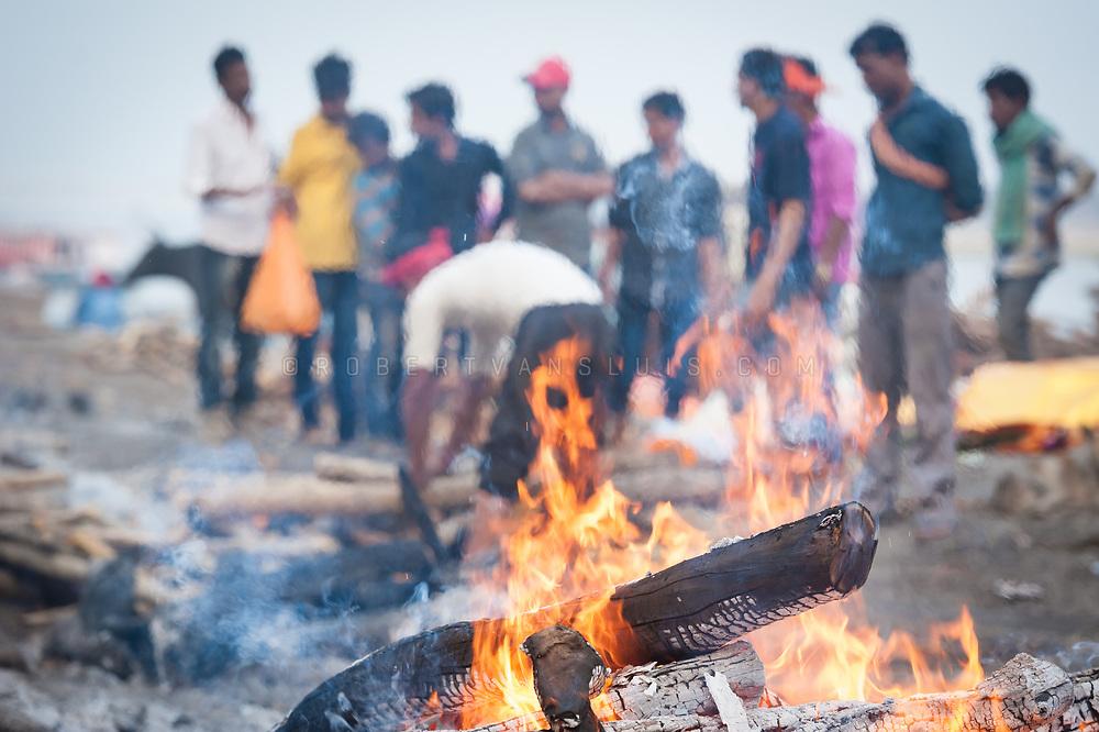 Flames rise from a funeral pyre at Manikarnika cremation ground, Varanasi, India. Photo ©robertvansluis.com