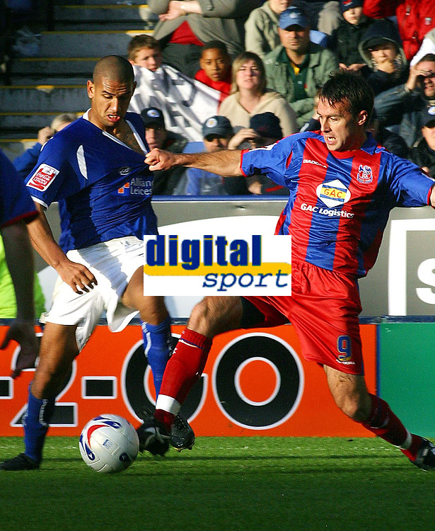 Photo: Dave Linney.<br />Leicester City v Crystal Palace. Coca Cola Championship. 21/10/2006.Leicester's .Patrick Kisnorbo(L)  battles for the ball with  Dougie Freedman