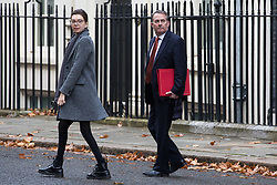 London, UK. 21st November, 2018. Liam Fox MP (r), Secretary of State for International Trade and President of the Board of Trade, leaves 10 Downing Street to attend Prime Minister's Questions at the House of Commons.