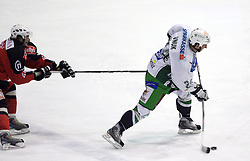 Gregor Poloncic stops Tomaz Vnuk of Olimpija at 2nd final match of Slovenian National Championships  between HK Acroni Jesenice and HDD Tilia Olimpija, on March 17, 2009, in Podmezaklja, Jesenice, Slovenia. Acroni Jesenice won after free shots 2:1 and are leading 2:0. They need to win 2-times more. (Photo by Vid Ponikvar / Sportida)