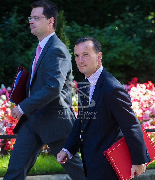 Downing Street, London, July 19th 2016. Northern Ireland Secretary James Brokenshire (left) and Welsh Secretary Alun Cairns arrives at the first full cabinet meeting since Prime Minister Theresa May took office.