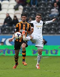 Hull's George Boyd battles with Swansea's Angel Rangel - Photo mandatory by-line: Matt Bunn/JMP - Tel: Mobile: 07966 386802 05/04/2014 - SPORT - FOOTBALL - KC Stadium - Hull - Hull City v Swansea City- Barclays Premiership