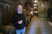 Oak barrel aging and fermentation cellar. Noel Pinguet, winemaker, owner. Domaine Huet, Vouvray, Touraine, Loire, France