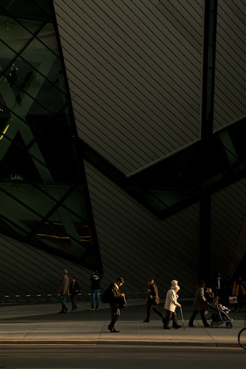 Pedestrians stroll by Daniel Liebeskind's addition to the Royal Ontario Museum on Toronto's Bloor Street.