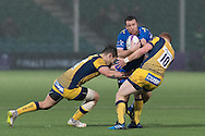 Adam Warren of the Newport Gwent Dragons is tackled by Connor Braid (r) and Ryan Mills (l) of the Worcester Warriors.  EPCR Challenge cup rugby match, pool 3, Worcester Warriors v Newport Gwent Dragons at the Sixways Stadium in Worcester, England on Saturday 10th December 2016.<br /> pic by  Simon Latham, Andrew Orchard sports photography.