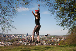 © Licensed to London News Pictures. 06/05/2013. Sheffield, UK. A woman walks across a slack-line in Meersbrook Park, Sheffield in the bank holiday sunshine. Photo credit : David Mirzoeff/LNP