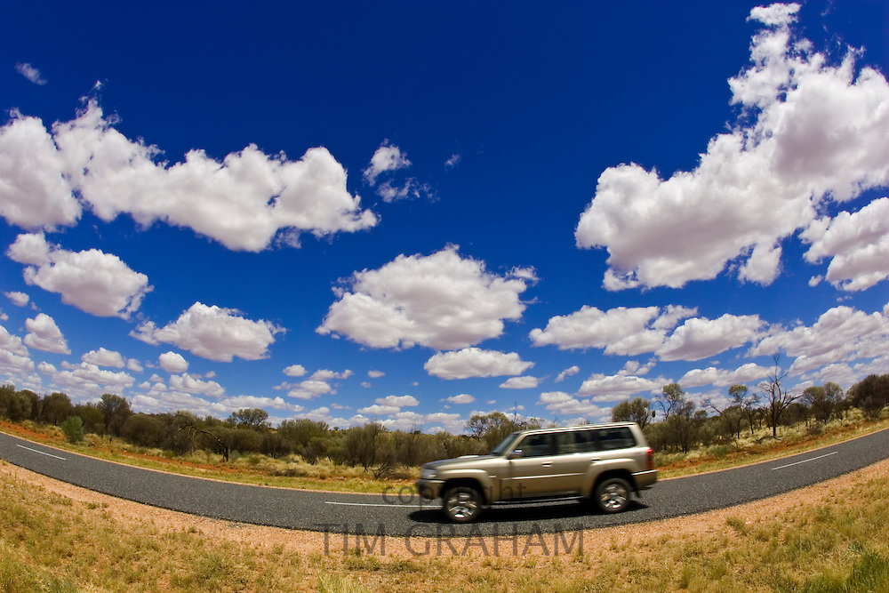 Four-wheel-drive vehicle on road in the Red Centre, Northern Territory, Australia