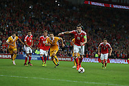 Gareth Bale of Wales  shoots and scores his teams 4th goal from the penalty spot. Wales v Moldova , FIFA World Cup qualifier at the Cardiff city Stadium in Cardiff on Monday 5th Sept 2016. pic by Andrew Orchard, Andrew Orchard sports photography
