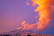 Evening light on clouds over Mount Rainier, Mount Rainier National Park, Washington