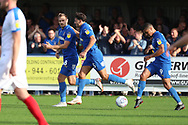 AFC Wimbledon striker James Hanson (18) celebrating after scoring goal to make it 1-2 during the EFL Sky Bet League 1 match between AFC Wimbledon and Portsmouth at the Cherry Red Records Stadium, Kingston, England on 13 October 2018.