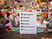 "15 JANUARY 2010 - TUCSON, AZ:   The memorial at Congresswoman Gabrielle Giffords office for victims of the mass shooting in Tucson, AZ, Saturday, January 15. Six people were killed and 14 injured in the shooting spree at a ""Congress on Your Corner"" event hosted by Arizona Congresswoman Gabrielle Giffords at a Safeway grocery store in north Tucson on January 8. Congresswoman Giffords, the intended target of the attack, was shot in the head and seriously injured in the attack but is recovering. Doctors announced that they removed her breathing tube Saturday, one week after the attack. The alleged gunman, Jared Lee Loughner, was wrestled to the ground by bystanders when he stopped shooting to reload the Glock 19 semi-automatic pistol. Loughner is currently in federal custody at a medium security prison near Phoenix.     PHOTO BY JACK KURT"