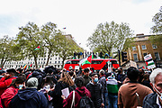 """London, United Kingdom, May 11, 2021: A group of Pro-Palestinian demonstrators climbed on a London Red bus of the public Transport outside Downing Street to protest against Israeli air raids on Gaza Strip. Demonstrators chanted """"Free-Free Palestine!"""" demanding the commitment of Great Britain to end their support for Israel. (Photo by Vudi Xhymshiti/VXP)"""