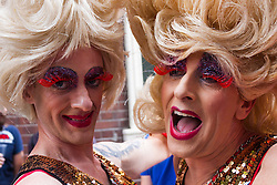 London, June 28th 2014. Two drag queens pose for a picture as thousands of London's LGBT community and their supporters throw a vast party in Soho.