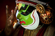"""Kathakali  (the word """"kathakali"""" literally means """"Story-Play"""") is one of the oldest theatre forms in the world, characteristic for  the south Indian state of Kerala. It has a long tradition dating back to the 17th century. <br /> <br /> It is a group presentation, in which dancers take various roles in performances traditionally based on religious and nature themes from Hindu mythology, especially the two epics, the Ramayana and the Mahabharata. <br /> <br /> Kathakali is widely recognizable for its distinctive costumes and sophisticated make up. Depending on a character the make up can be predominantly green (fhe faces of noble male characters, such as virtuous kings, the divine hero Rama etc.), green slashed with red marks on the cheeks (characters of high birth who have an evil streak, such as the demon king Ravana) or predominantly red (extremely angry characters). All the make up's  are made from natural materials: the white one is made from rice flour, the red from Vermillion and the black is made from sook. <br /> <br /> The actors rely very heavily on hand gesture to convey the story.These hand gestures, known as mudra, are common through out much of classical Indian dance. The body movements and footwork are very rigourous. To attain such a high level of of flexibility and muscle control required for this art, a Kathakali dancer needs years of a strenuous training special body massages.<br /> <br /> Although a traditional Kathakali performance is a major social event, which usually starts at dusk and lasts for the whole night culminating at the dawn hour, when Good finally conquers Evil, today sometimes it is modified for smaller urban audiences."""