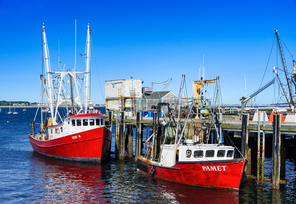 Commercial fishing boats docked at MacMillan Wharf, Provincetown, Cape Cod, Massachusetts, USA.