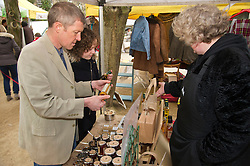 Pictured: Willie Rennie, Hannah Betsworth and Chelly Campbell from That's Jammy who were at the market for the first time.<br /> <br /> Liberal Democrat leader Willie Rennie and  Hannah Bettsworth, Liberal Democrat candidate for Edinburgh Central and the Lothian regional list, headed to Stockbridge today to meet Easter shoppers and stallholders at the Sunday farmers market. <br /> <br /> Ger Harley | EEm 27 March 2016