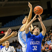 011915  Adron Gardner/Independent<br /> <br /> Window Rock Scout Trent Long (44), center left, and Valley Sanders Pirate Harold Matt (32) reach for a rebound at the Stronghold Event Center in Fort Defiance Monday.