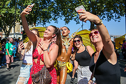 © Licensed to London News Pictures. 26/08/2019. London, UK. Members of public take a selfie with a dance on the second day of Notting Hill Carnival in west London. Thousands of revellers take part in Notting Hill Carnival, Europe's largest street party and a celebration of Caribbean traditions and the capital's cultural diversity. Photo credit: Dinendra Haria/LNP