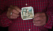 In this July 26, 2015 photo, Pablo Ibarra, 75, poses for a photo holding a family snapshot from 1980, that shows him with his wife Francisca Santiago and their son Pablo, in Santa Ana, in the Mexican state of Oaxaca. In 46 years of a civil marriage, Ibarra and Santiago have had eight children and several grandchildren. But until Pope Francis' reforms to the church's annulment process went into effect on Dec. 8, 2015, they didn't think they could be married in a religious ceremony, because Ibarra was a divorcee. NICK WAGNER / ASSOCIATED PRESS