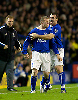 Photo. Jed Wee.<br /> Everton v Leicester City, FA Barclaycard Premiership, Goodison Park, Liverpool. 20/12/2003.<br /> Everton manager David Moyes (L) cannot stop smiling as David Unsworth (R) congratulates goalscorer Wayne Rooney.