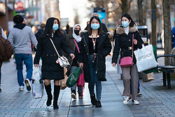 Glasgow, Scotland, UK. 19 November 2020. On the day before the highest level 4 lockdown is imposed on west and central Scotland, shops in Glasgow city centre and streets are busy with members of the public. Pictured; Three asian women shopping on Sauchiehall Street.  Iain Masterton/Alamy Live News