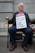 On US President Donald Trumps second day of a controversial three-day state visit to the UK, the veteran CND campaigner Bruce Kent sits among protesters voicing their opposition to the 45th American President, in Trafalgar Square, on 4th June 2019, in London England. Bruce Kent is a British political activist and a former Roman Catholic priest. Active in the Campaign for Nuclear Disarmament, he was the organisations general secretary from 1980 to 1985 and its chair from 1987 to 1990.