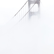 San Francisco's Golden Gate Bridge obscured by dense fog