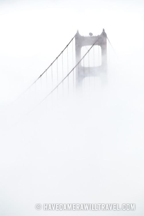 San Francisco's Golden Gate Bridge obscured by dense fog