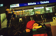 Czech families squat Calais Passenger Terminal, sleeping rough, before moving on somewhere else<br /><br />Eastern European Roma are subject to strict border controls by police and immigration officials whilst trying to enter the United Kingdom. Aided by Special forces Czech Roma Police who check peoples racial identity through their names or other means, disallow certain people from crossing the frontier. Subsequently Roma return to Calais and squat in Passenger Terminal. Calais, France.