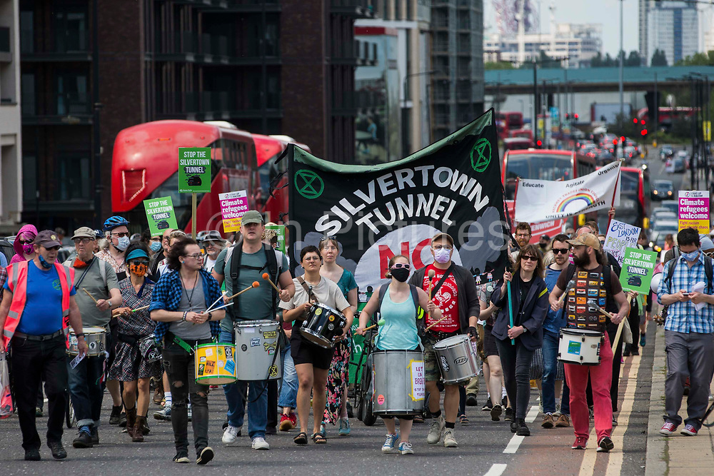 Environmental activists and local residents protest against the construction of the Silvertown Tunnel on 5th June 2021 in London, United Kingdom. Campaigners opposed to the controversial new £2bn road link across the River Thames from the Tidal Basin Roundabout in Silvertown to Greenwich Peninsula argue that it is incompatible with the UKs climate change commitments because it will attract more traffic and so also increased congestion and air pollution to the most polluted borough of London.