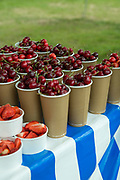 Strawberries and cherries on sale at the annual Suffolk Show on the 29th May 2019 in Ipswich in the United Kingdom. The Suffolk Show is an annual show that takes place in Trinity Park, Ipswich in the English county of Suffolk. It is organised by the Suffolk Agricultural Association.