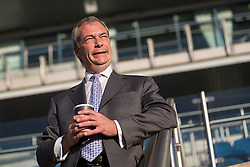 © Licensed to London News Pictures . 25/09/2015 . Doncaster , UK . NIGEL FARAGE drinking a cup of coffee at the 2015 UKIP Party Conference at Doncaster Racecourse , this morning (Friday 25th September 2015) . Photo credit : Joel Goodman/LNP