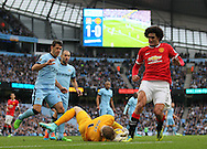 Joe Hart of Manchester City saves at the feet of Marouane Fellaini of Manchester United - Barclays Premier League - Manchester City vs Manchester Utd - Etihad Stadium - Manchester - England - 2nd November 2014  - Picture David Klein/Sportimage
