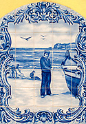 Traditional Painted Ceramic Tiles panel representing a fisherman and his boat on the beach of Nazare, Portugal