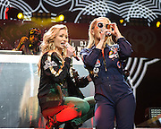 """WASHINGTON, DC - December 15th, 2014 - Iggy Azalea  and Rita Ora perform onstage during HOT 99.5's Jingle Ball 2014 at the Verizon Center in Washington, D.C. Her single """"Fancy"""" reached number one on the Billboard Hot 100. (Photo By Kyle Gustafson / For The Washington Post)"""