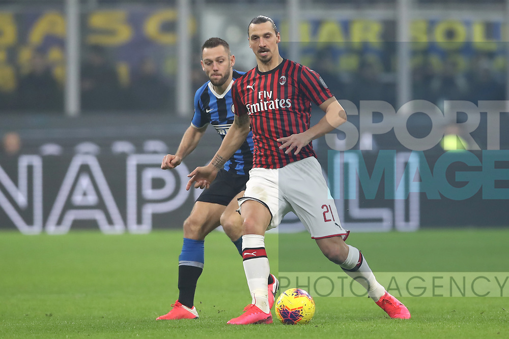 Zlatan Ibrahimovic of AC Milan plays the ball under pressure from Stefan de Vrij of Inter during the Serie A match at Giuseppe Meazza, Milan. Picture date: 9th February 2020. Picture credit should read: Jonathan Moscrop/Sportimage