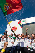 Portuguese team singing the portuguese anthem with supporters at Alameda Dom Afonso Henriques, in Lisbon. Portugal's national squad won the Euro Cup the day before, beating in the final France, the organizing country of the European Football Championship, in a match that ended 1-0 after extra-time.