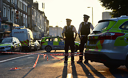 Police officers man a cordon in Finsbury Park, north London, where one man has died, eight people taken to hospital and a person arrested after a van struck pedestrians.