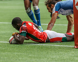 March 10, 2018 - Vancouver, British Columbia, U.S. - VANCOUVER, BC - MARCH 10: Samuel Oliech (#10) of Kenya scores despite Jonathan Laugel (#1) of France  during Game # 3- Kenya vs France Pool C match at the Canada Sevens held March 10-11, 2018 in BC Place Stadium in Vancouver, BC. (Photo by Allan Hamilton/Icon Sportswire) (Credit Image: © Allan Hamilton/Icon SMI via ZUMA Press)