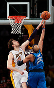 Los Angeles Lakers forward Pau Gasol attempts to block a shot by Dallas Mavericks guard Vince Carter during the second half of an NBA basketball game, Sunday, April 15, 2012, in Los Angeles. The Lakers won 112-108. (AP Photo/Bret Hartman)