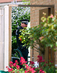 © London News Pictures. 10/06/2012.  Ampthill, UK. A Police officer in the back garden of the property in Amphill, Bedfordshire, where 15-year-old Megan-Leigh Peat died in the early hours of Saturday morning. It is believed that Schoolgirl Megan-Leigh Peat was stabbed to death at a house party thrown by a boy whose parents are away on holiday. Photo credit: Ben Cawthra/LNP