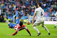 Real Madrid's player Nacho Fernandez and Sporting de Gijon's player Douglas during match of La Liga between Real Madrid and Sporting de Gijon at Santiago Bernabeu Stadium in Madrid, Spain. November 26, 2016. (ALTERPHOTOS/BorjaB.Hojas)